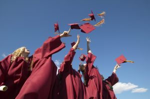 Women Throwing Hats in the Air on Graduation Day